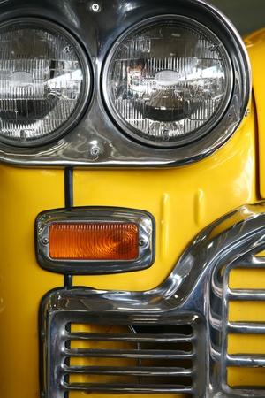 yellow car: A yellow retro car headlight