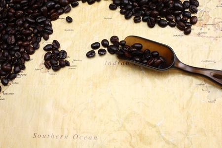 coffee beans on world map background photo