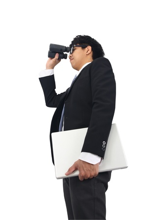 Asia Business Man with spyglass binoculars  Stock Photo - 11877665