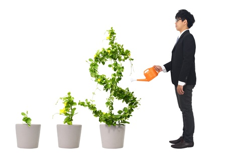growth in economy: asia young business man and orange water can (path in side) Stock Photo