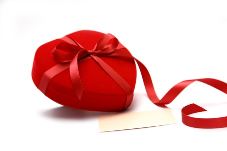 close up Red velvet Heart Shaped Box and ribbon.  photo