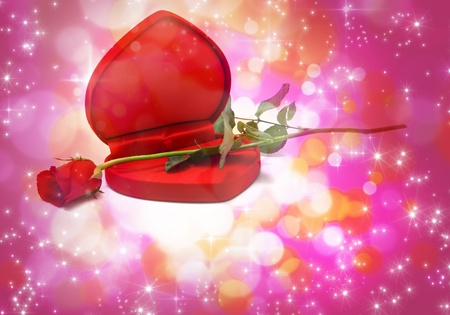 red rose bokeh: Valentines Day Red Heart Shaped Box and rose. Stock Photo