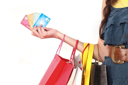 credit card purchase: hand of woman holding shopping bags and credit card
