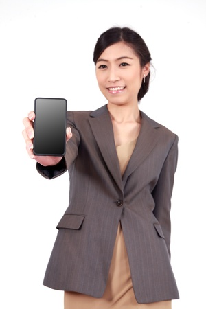 Business Woman Showing blank display of touch mobile cell phone (Focus on the hand and phone) photo