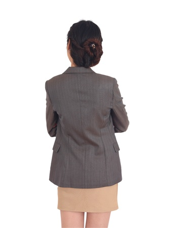 Asian woman from the back, looking at something isolated Stock Photo - 11981415