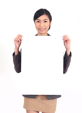holding a sign: Asian business woman holding a blank billboard on white
