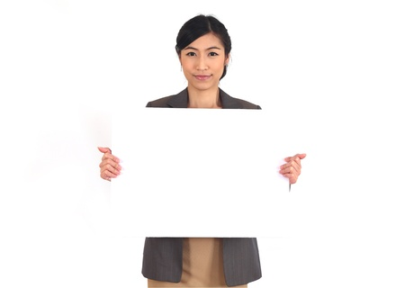 Asian business woman holding a blank billboard on white  photo