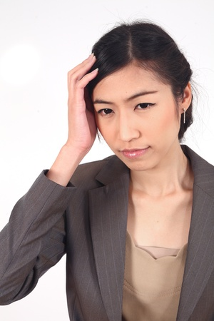 hair problem: Business woman with bad headache holding head over white background