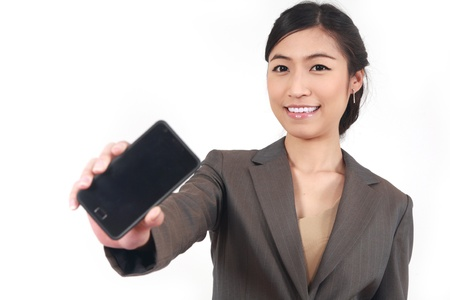Business Woman Showing blank display of touch mobile cell phone (Focus on face smileing)  photo