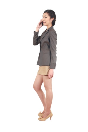 Asian Business woman talking on smart phone isolated over a white background