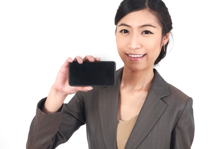 Business Woman Showing blank display of touch mobile cell phone (Focus on face snile) photo
