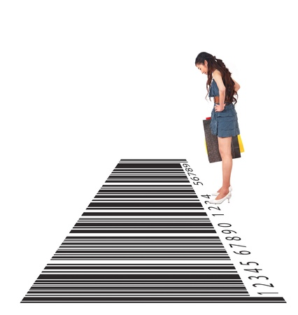 woman looking down: Shopping, woman looking down barcode  Stock Photo