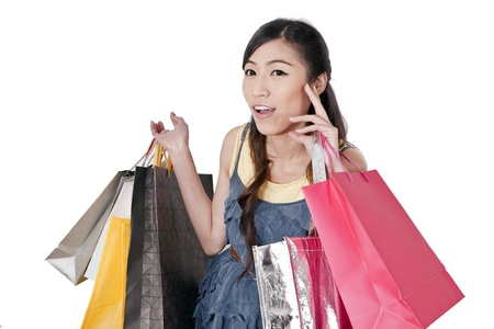 Portrait of happy girl shopping over white background  photo