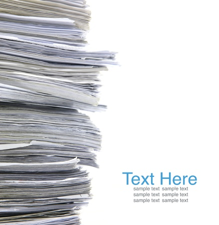office chaos: close up stack of paper on white background