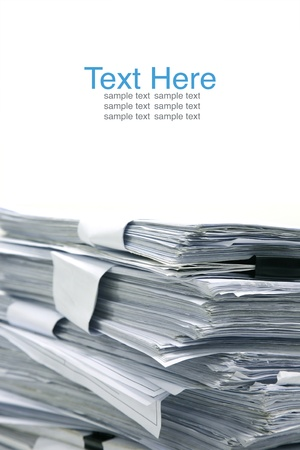 blank newspaper: close up stack of paper on white background