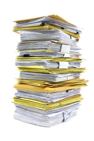 office chaos:  stack of papers isolated on white