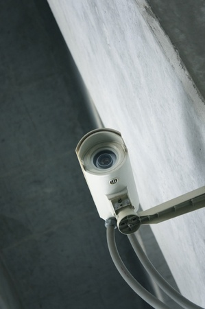 security cameras on front of glass building 