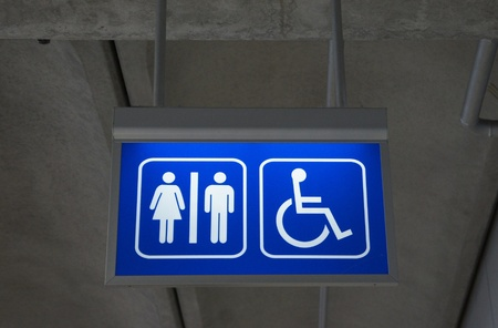 Men and women toilet sign with an arrow showing direction  photo