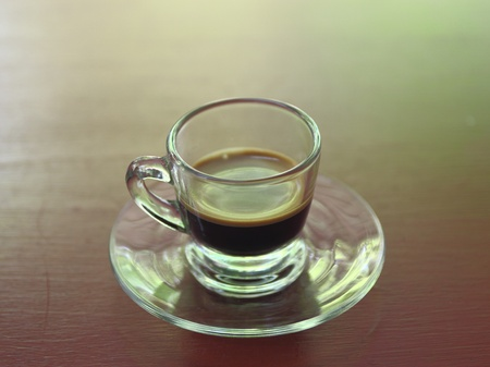 Close-up Espresso coffee on brown background   photo