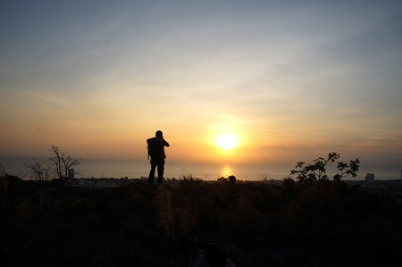 Silhouette of a photographer at sunset Stock Photo - 12857938