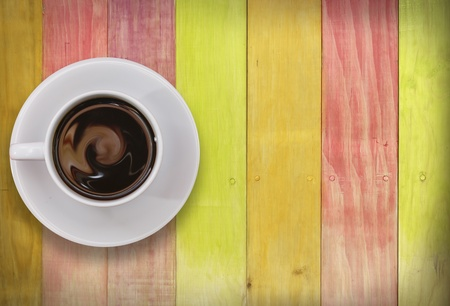 Coffee cup top view on colors wooden