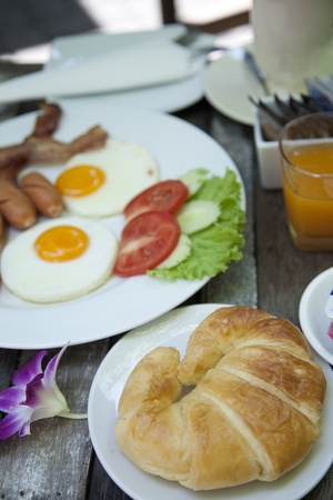 American breakfast  on wooden table  photo