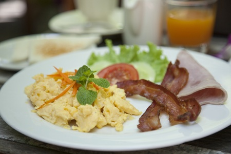 American breakfast Omelette  on wooden table  photo