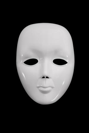 Plain white mask against a dark background.   photo