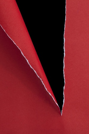 vertical divider: red ripped paper on dark background  Stock Photo