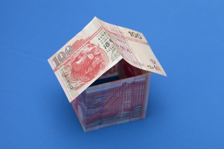 hk: 100 dollars hongkong house on blue background