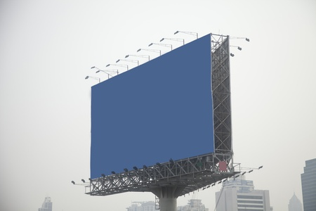 blue billboard on city photo
