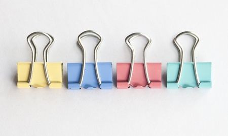 separator: colors metal paperclips on white background