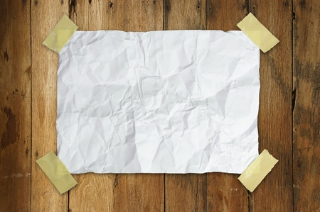sticking: crumpled paper is taped on a wooden wall with path