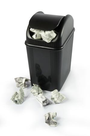 bucket of money: full dollar paper money trash bin Stock Photo