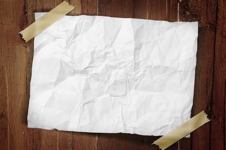 taped: A sheet of crumpled paper is taped on a wooden wall with a path  Stock Photo
