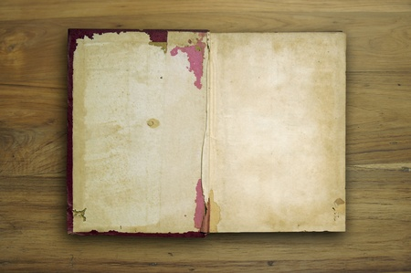 yellowed: Old book Open two face on wood