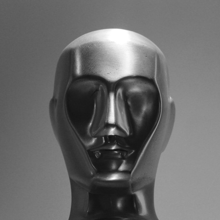 statuette: abstract face metal sculpture.  Stock Photo
