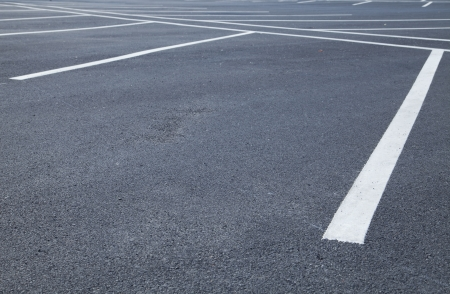 new car lot: Acres of empty parking spaces