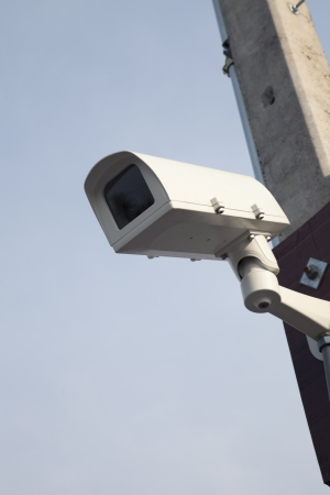 security camera on blue sky photo