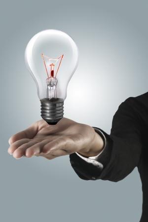 Light bulb on hand Stock Photo - 13636055