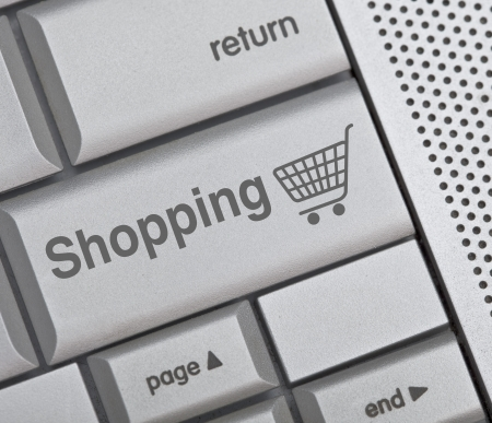 Computer blue keyboard with on-line shopping symbol on it Stock Photo - 13636251