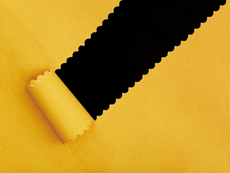 yellow Torn Paper frame on dark background  photo