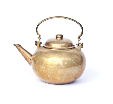 Ancient ornamental teapot, jug on white background  photo