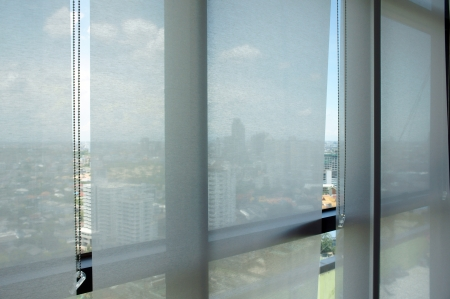 office window view: Curtain office shutterblinds, on day Stock Photo