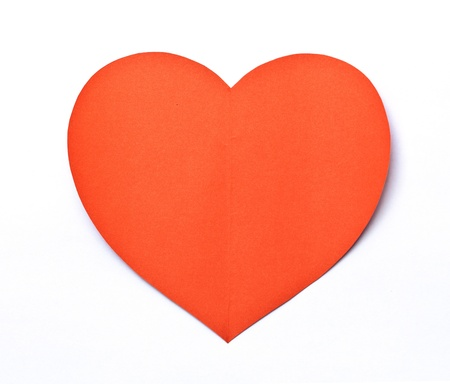Red Heart paper shape symbol on white photo