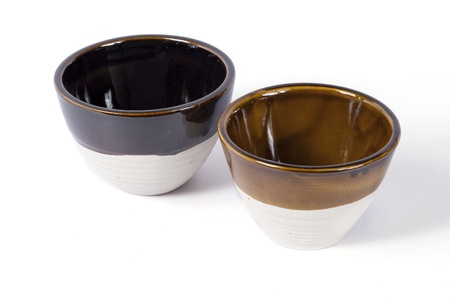 two brown bowls on white background  photo