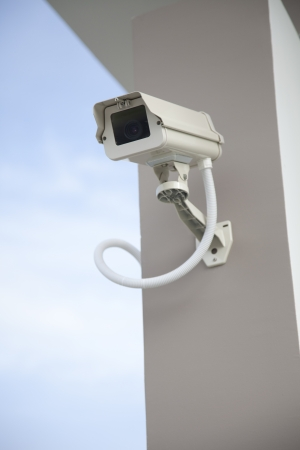 CCTV security camera at home on sky.  photo