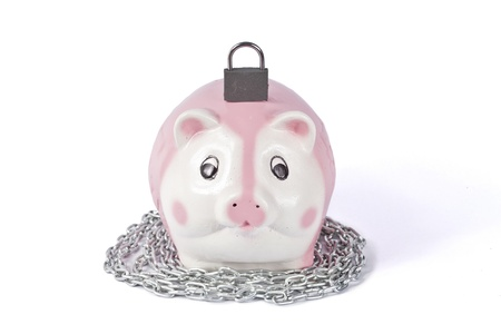 secure money: Piggy bank with padlock on white