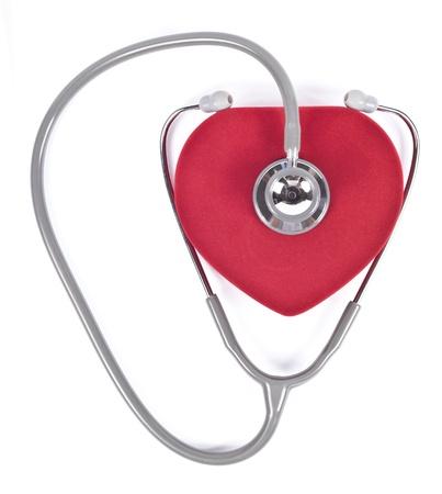 stethoscope and velvet heart on white.  photo