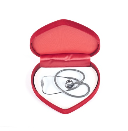 stethoscope in velvet heart on white.  photo